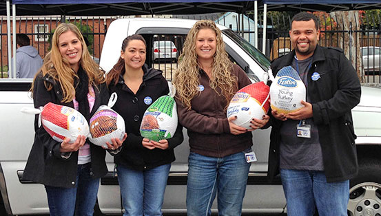 Generous state employees holding donated turkeys